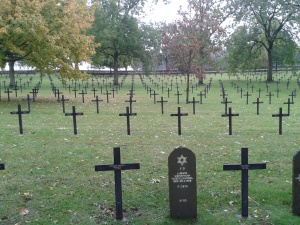 A rare sight; 1. A German WW1 Cemetery in France 2. Note the irony of the headstone. Each cross marks 4 graves. There are 17,027 bodies here, at Fricourt